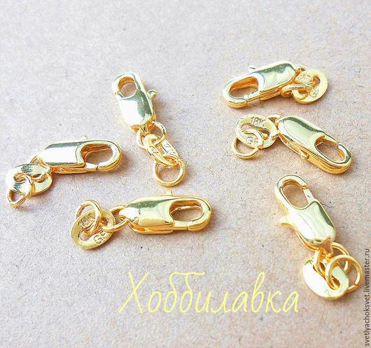 Золотые (Gold Filled) из наполненного 18 карат (стоит штамп) золота  замочки-лобстеры для украшений.  Размер 12 мм с одним колечком .  Полностью длина с двумя колечками и перегородкой со штампом 19 мм