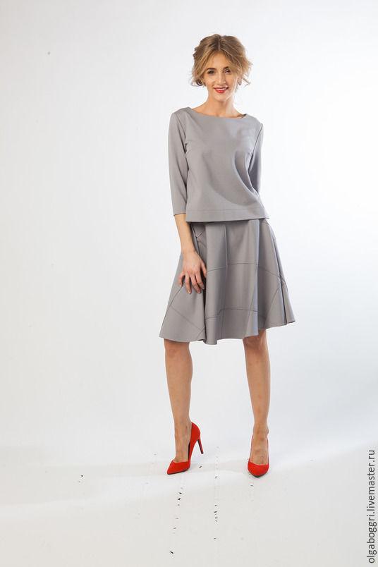 Женские костюмя платья на выход