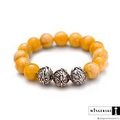 Украшения handmade. Livemaster - original item Women`s bracelet made of Baltic amber with silver charms. Handmade.