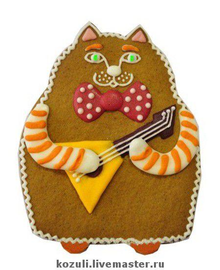 Пряничного кота можно сделать с любым музыкальным инструментом.