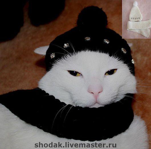 шапка украшена стразами,помпон-норка