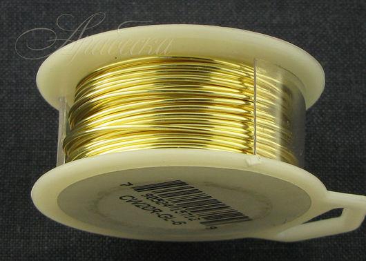 Проволока сияющего золотого цвета медная  0.81мм (20ga) BEADSMITH (США)
