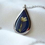 Украшения handmade. Livemaster - original item Pendant in titanium and resin jewelry with real flowers on blue ground. Handmade.