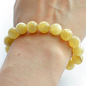 Украшения handmade. Livemaster - original item A bracelet made of beads lemon Simbircite Ø11 mm. Handmade.