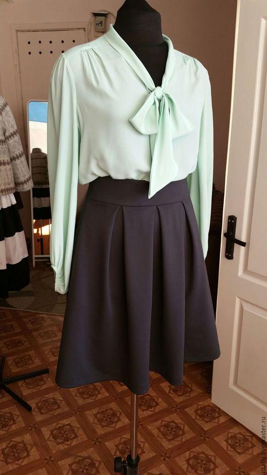 женская юбка клеш из джерси с боковыми карманами