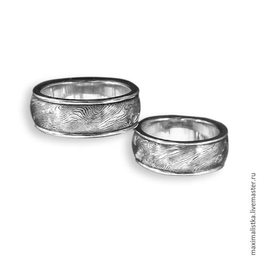 Обручальные кольца `Слияние...` с дамасской сталью и белым золотом в Москве изготовление на заказ