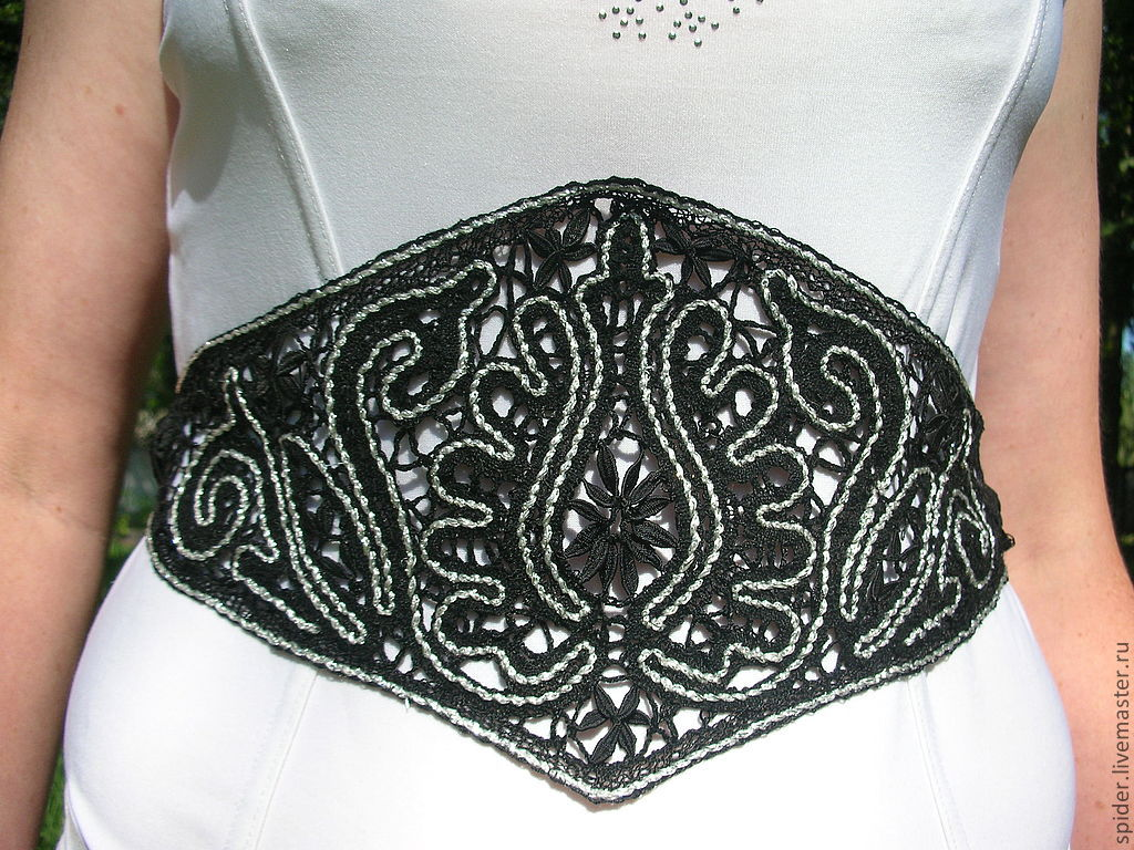 Silver threads (filigree ) emphasizes the intricate patterns of Vologda lace