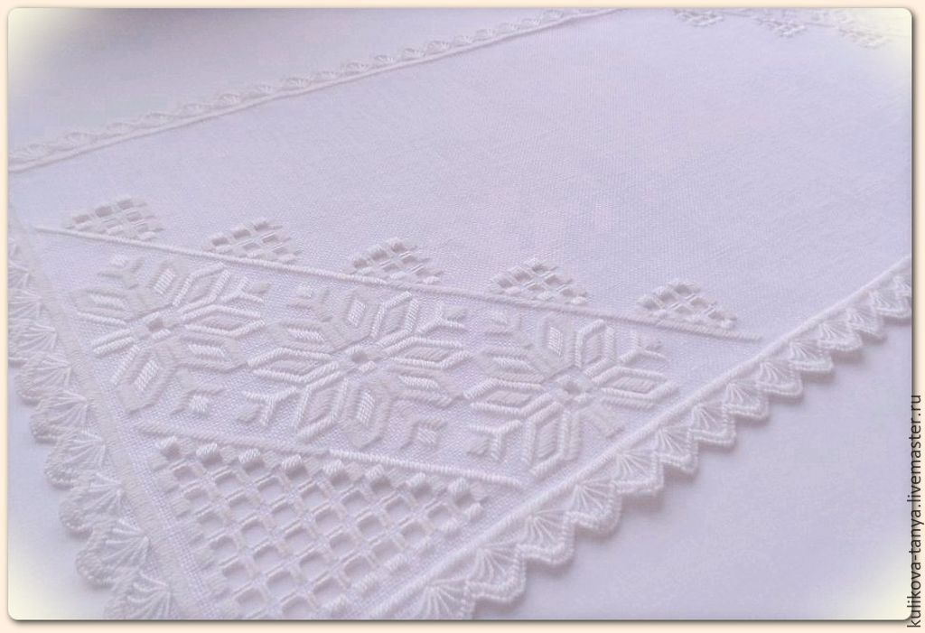 An embroidered cloth path on the table with a hand embroidered festive table decoration a good gift for a beautiful cozy home