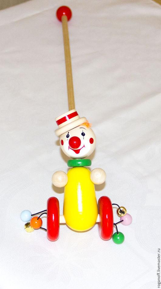 Детские каталки с ручкой `Клоун`