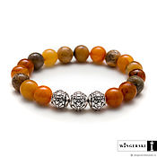 Bead bracelet handmade. Livemaster - original item The Damascus bracelet from Baltic amber with silver charms. Handmade.