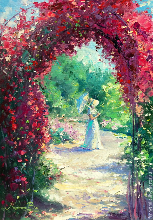 The garden through the arch with roses.
