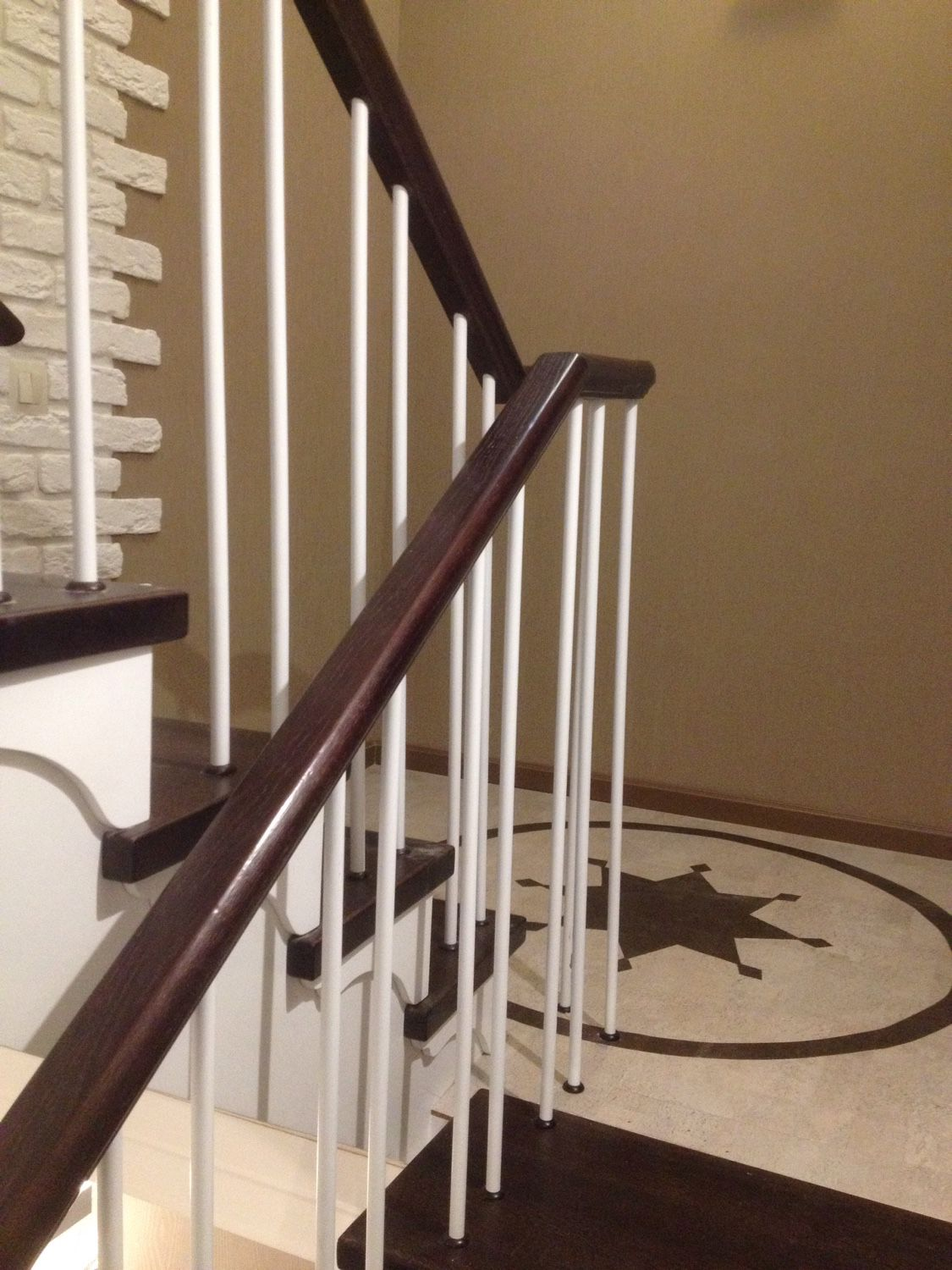 Staircase in a modern style with oak treads, white balusters and handrail. Made of wood in my project.