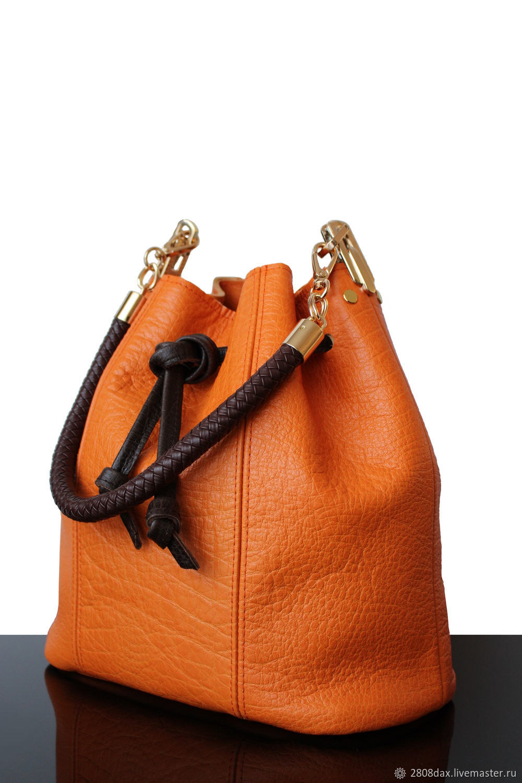 e8c4d4e11b Orange leather handbag