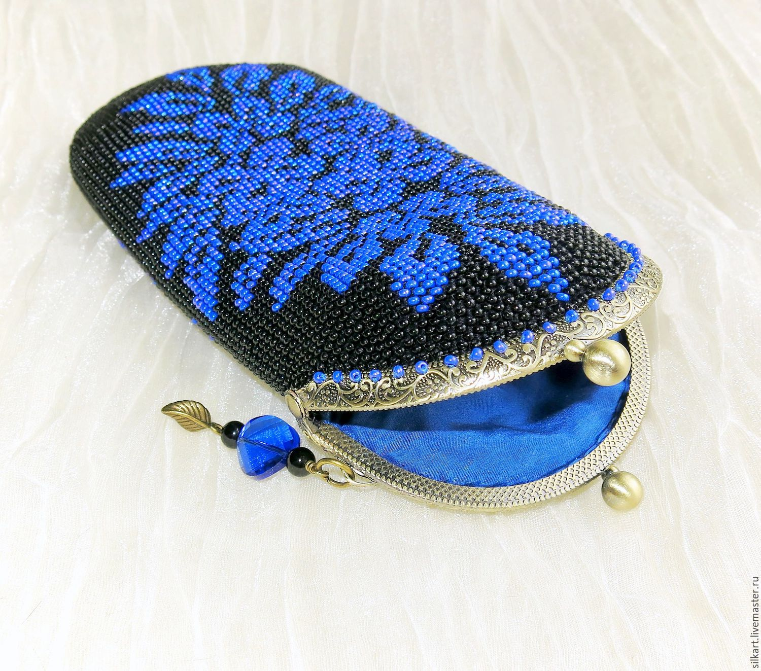 Eyeglass case beaded with clasp `Theater`. Blue drawing on a black background.