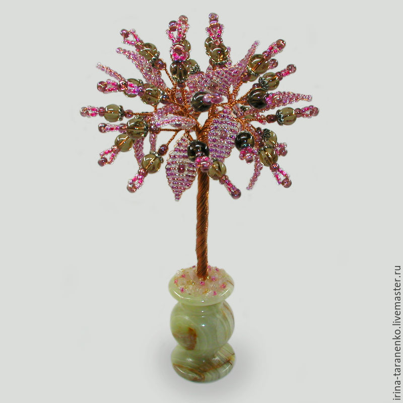 Tree of happiness from smoky quartz in a vase of onyx