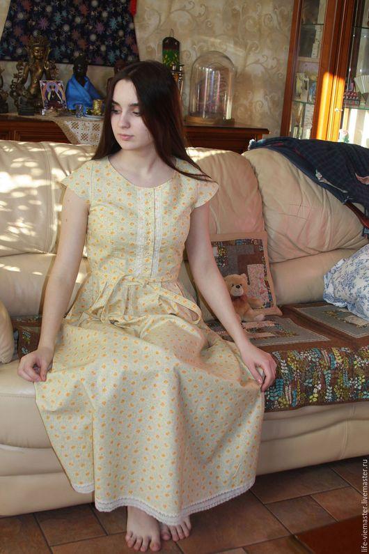 Платье из американского хлопка  украшено нежным кружевом .