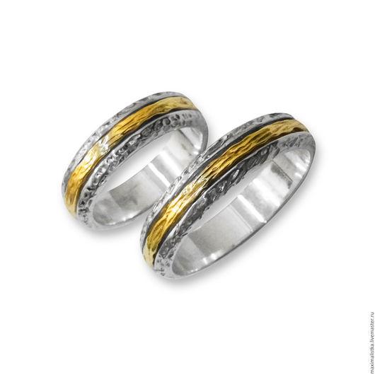 Обручальные кольца `Союз двух сердец` - изготовлены из серебра 925 пробы с вращающейся серединой из жёлтого золота 585 пробы.