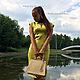 Оливковое платье с вырезом