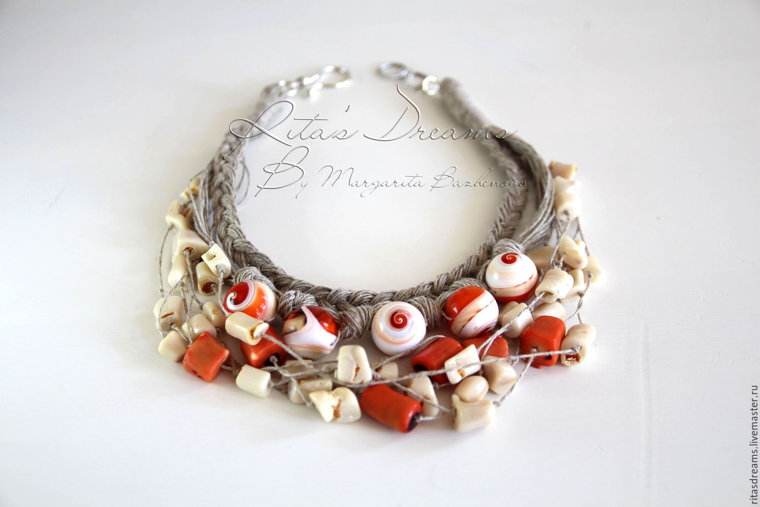 Surround necklace made of linen with white and orange coral and shells. All beads of this necklace are born in the sea and keep a piece of it...