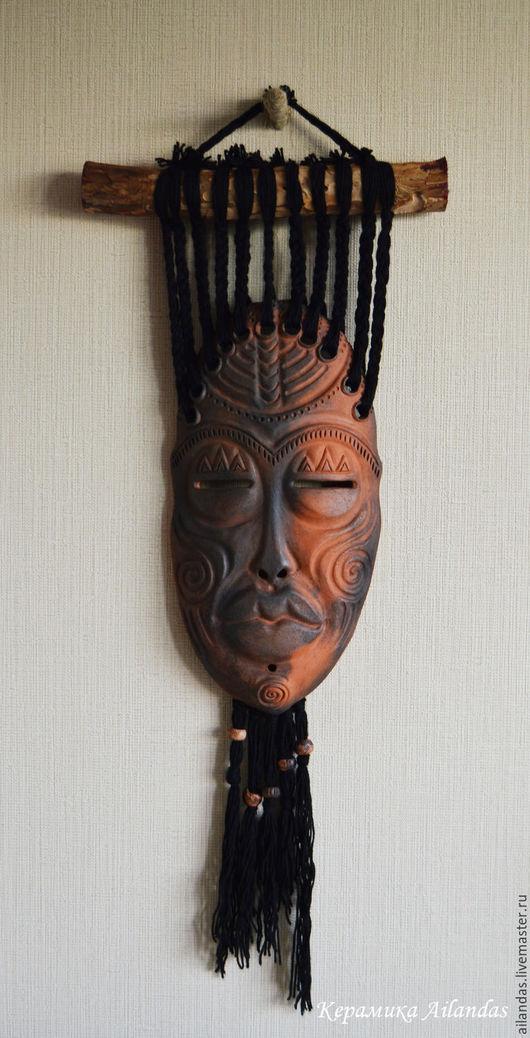Маска. Настенное панно. Свободная стилизация на Африканские маски.  Керамика., Дымленый обжиг., Нить., Вишневая ветка., Керамические бусины.   размер керамической маски 35х18 см., длинна всего п