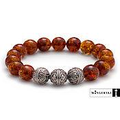 Сувениры и подарки handmade. Livemaster - original item Men`s and women`s bracelet made of Baltic amber with silver charms. Handmade.