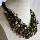 Yellow, brown and bronze beads on black waxed cord with a large clasp-toggle - versatile piece for every day, a small bar, giving a finish to the image.