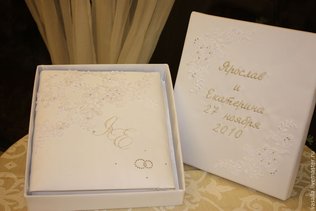 personalized wedding album and a folder for the marriage certificate