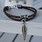 Украшения handmade. Livemaster - original item Braided leather bracelet with a Feather pendant. Handmade.