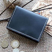 Сумки и аксессуары handmade. Livemaster - original item A small black wallet with a coin holder with a zipper. Handmade.