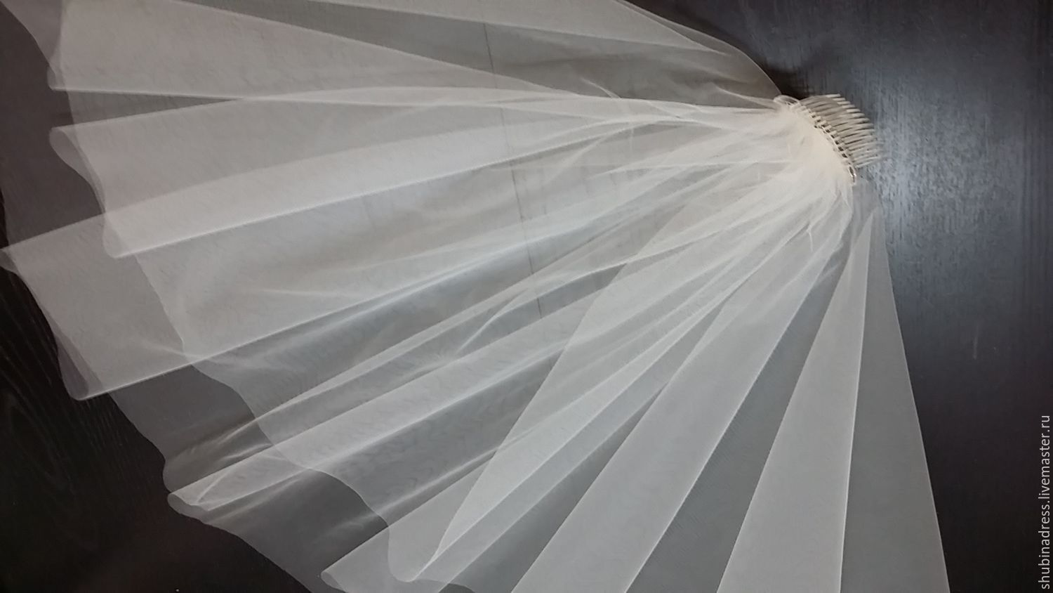 Veil `Alina` with a simple (trimmed) edge is available in two colors: white and milk ( ivory ). This model of wedding veils is suitable for almost any outfit.