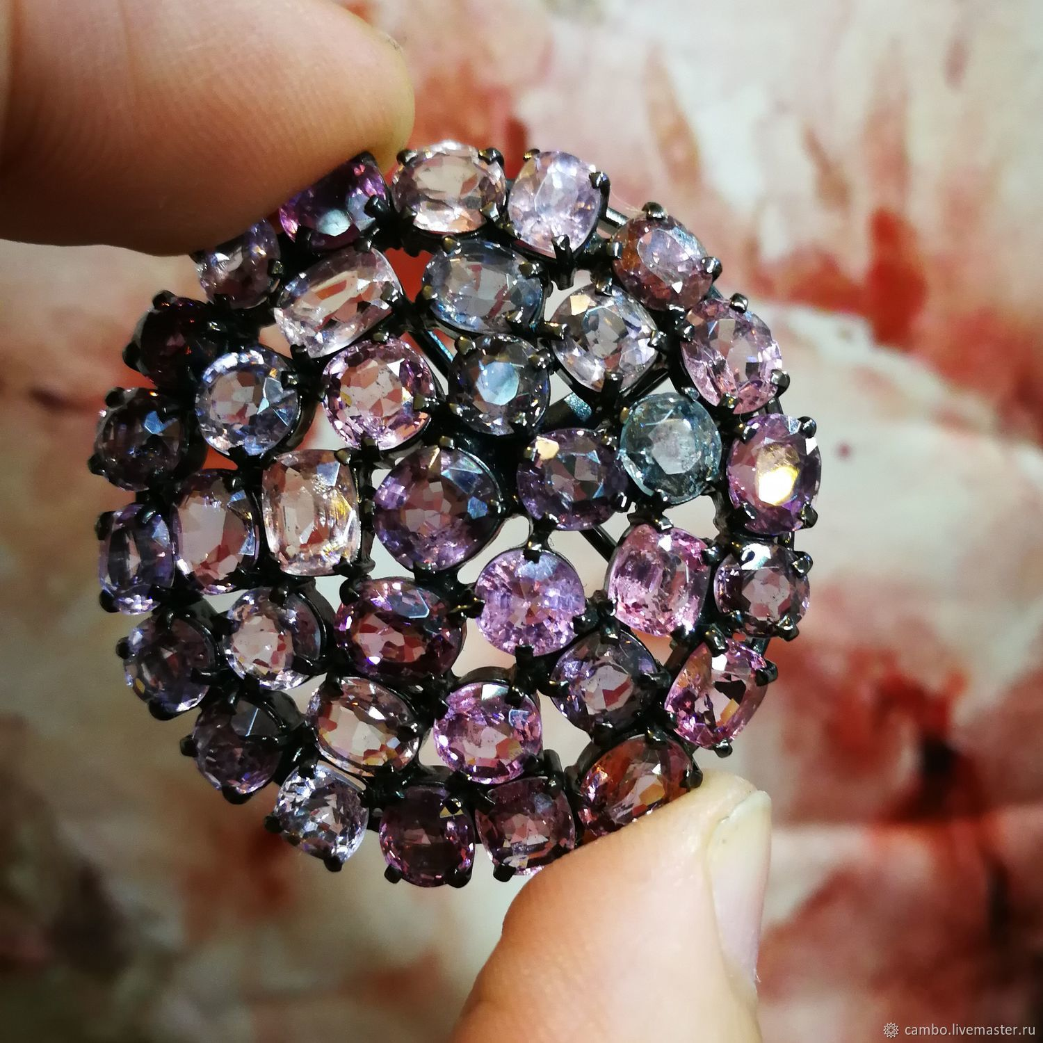 Brooch pendant in silver with spinel lilac-pink color.