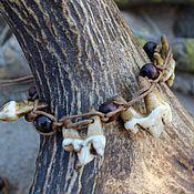 Русский стиль handmade. Livemaster - original item A bracelet made of the teeth of the wolf