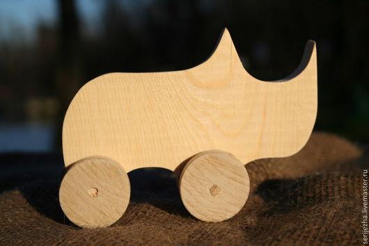 Носорог-каталка деревянная игрушка ручной работы