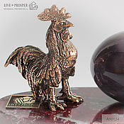 Сувениры и подарки handmade. Livemaster - original item Bronze Rooster egg from charoite on a plate of marble. Handmade.