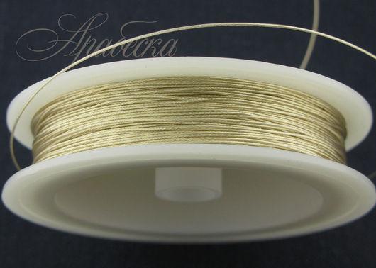 Тросик ювелирный  светло-золотого цвета 0.47мм BEADALON (США) 0.5м