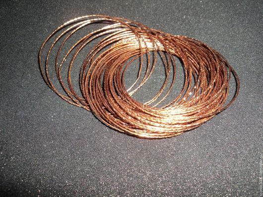 Браслет из анодированной меди, состоящий из пятидесяти тонких браслетиков,закрепленных один за другой `восьмеркой` - не рассыплются.
