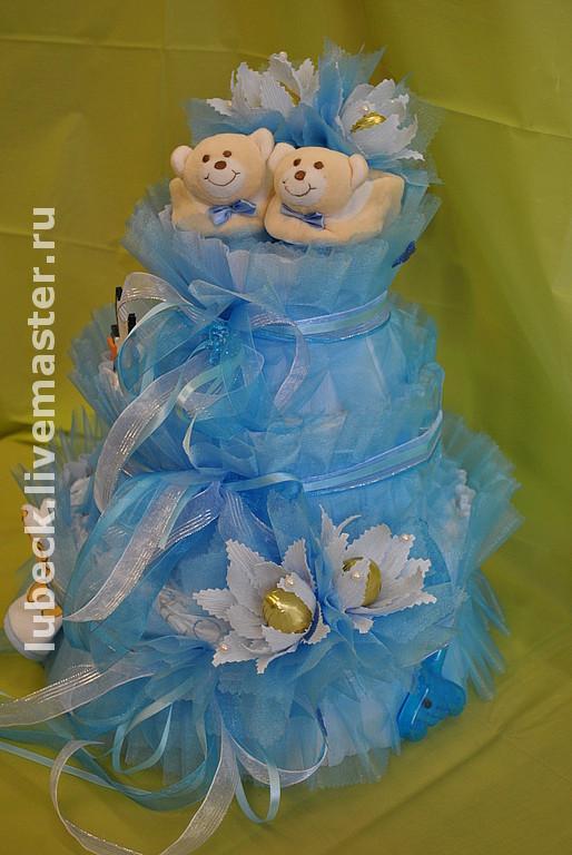 Тортик из японских  (Moony  Goony  Merries) подгузников   Начинка   пинетки  бутылочки  боди  шапочки  салфетки  носочки  игрушки прорезыватели   термометр для воды