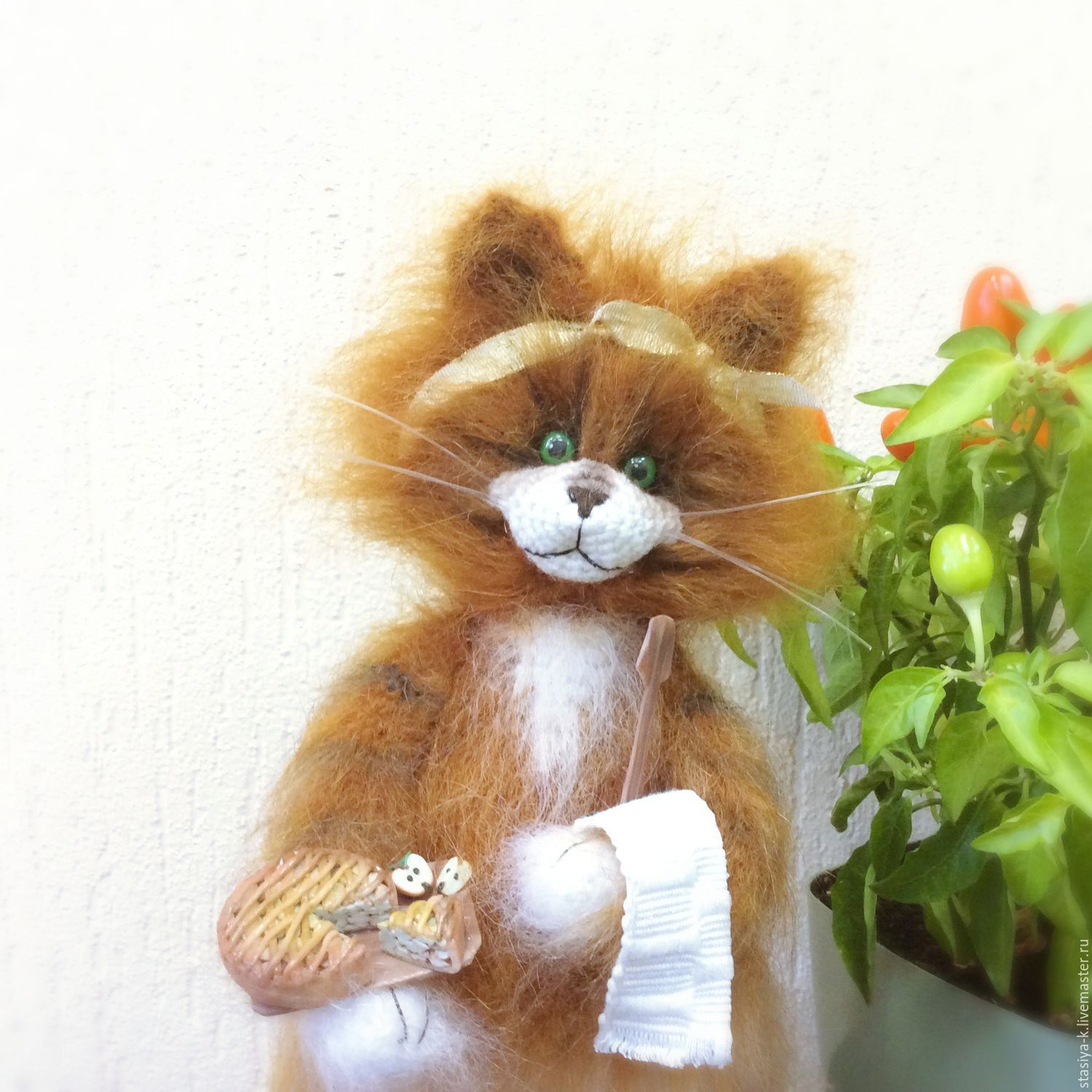 author's interior knitted soft toy `kitty powercheck`.