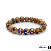 Сувениры и подарки handmade. Livemaster - original item Women`s bracelet made of Baltic amber with silver charms. Handmade.