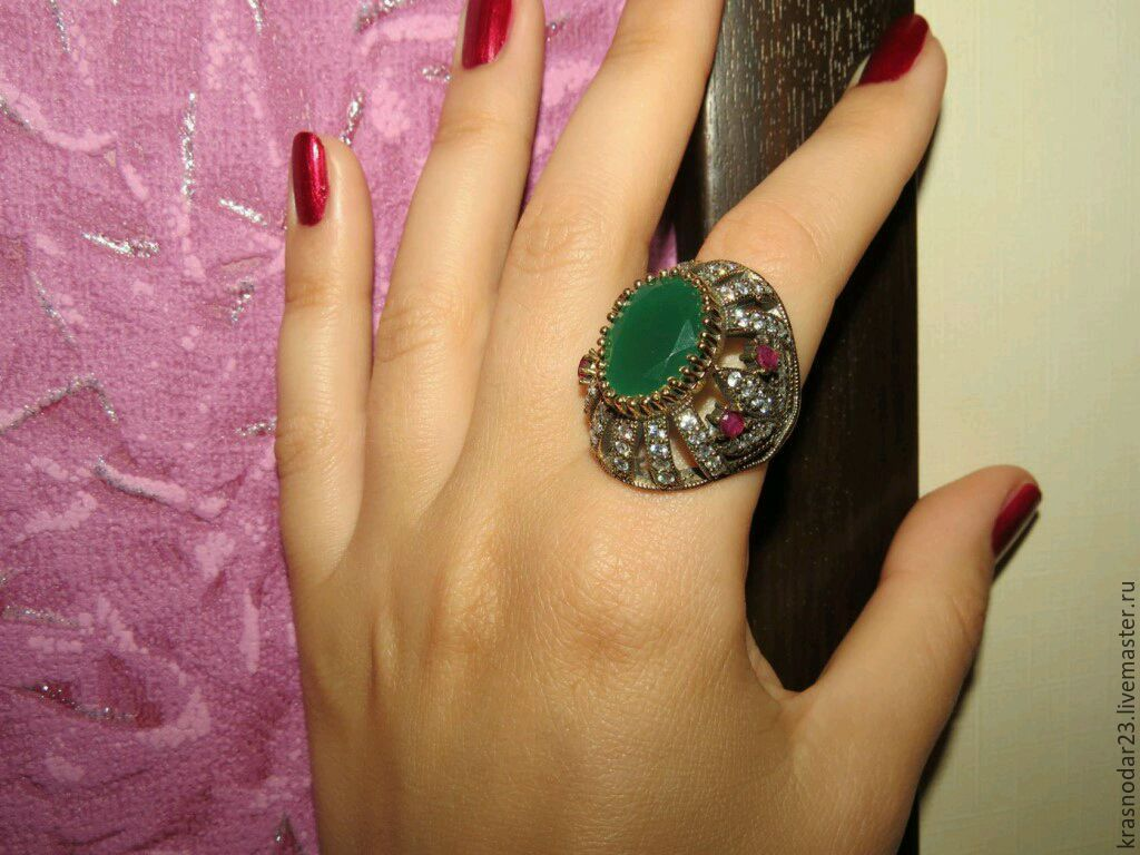 Ring of 925 SILVER with an antiqued finish (patina) with a chrysoprase, which is framed by sparkling cubic Zirconia and pink rubies