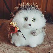 Куклы и игрушки handmade. Livemaster - original item The cutest hedgehog with a flower (toy made of wool). Handmade.