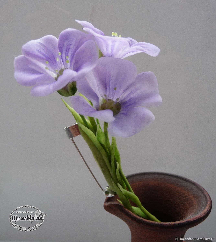 Handmade flowers,handmade jewelry,original works of polymer clay.