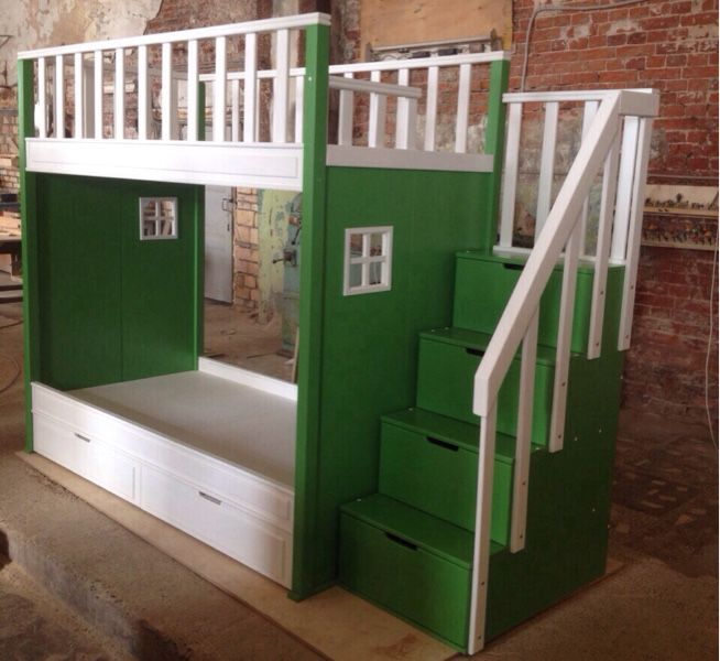 Children bunk bed with staircase, decorative Windows. The storage system is represented by two spacious drawers and small niches, arranged in stairs