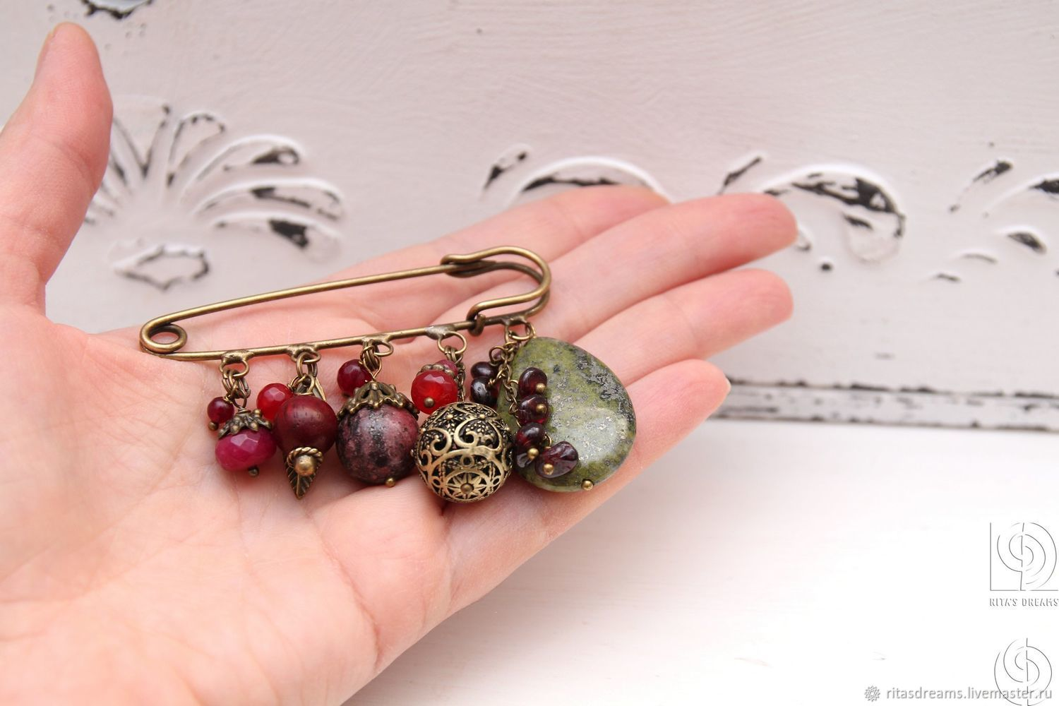 Large brooch safety pin for scarf, stole, coat, cardigan or other knitwear items. Garnet and jade-toned berry shades complement large drop of Jasper the color of faded grass.
