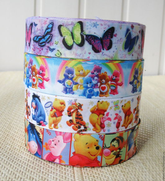 Репсовая лента шириной 25 мм. с 3D рисунком . В наличии 4 разных вида репсовой ленты с рисунками из любимых мультиков для отделки и декора игрушек и детских вещей.