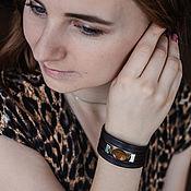 Украшения handmade. Livemaster - original item Wide dark leather bracelet on the hand of a woman with a tiger`s eye. Handmade.