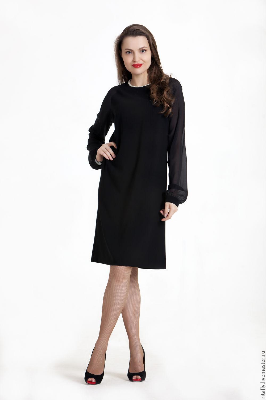 Черное платье с рукавом до колена