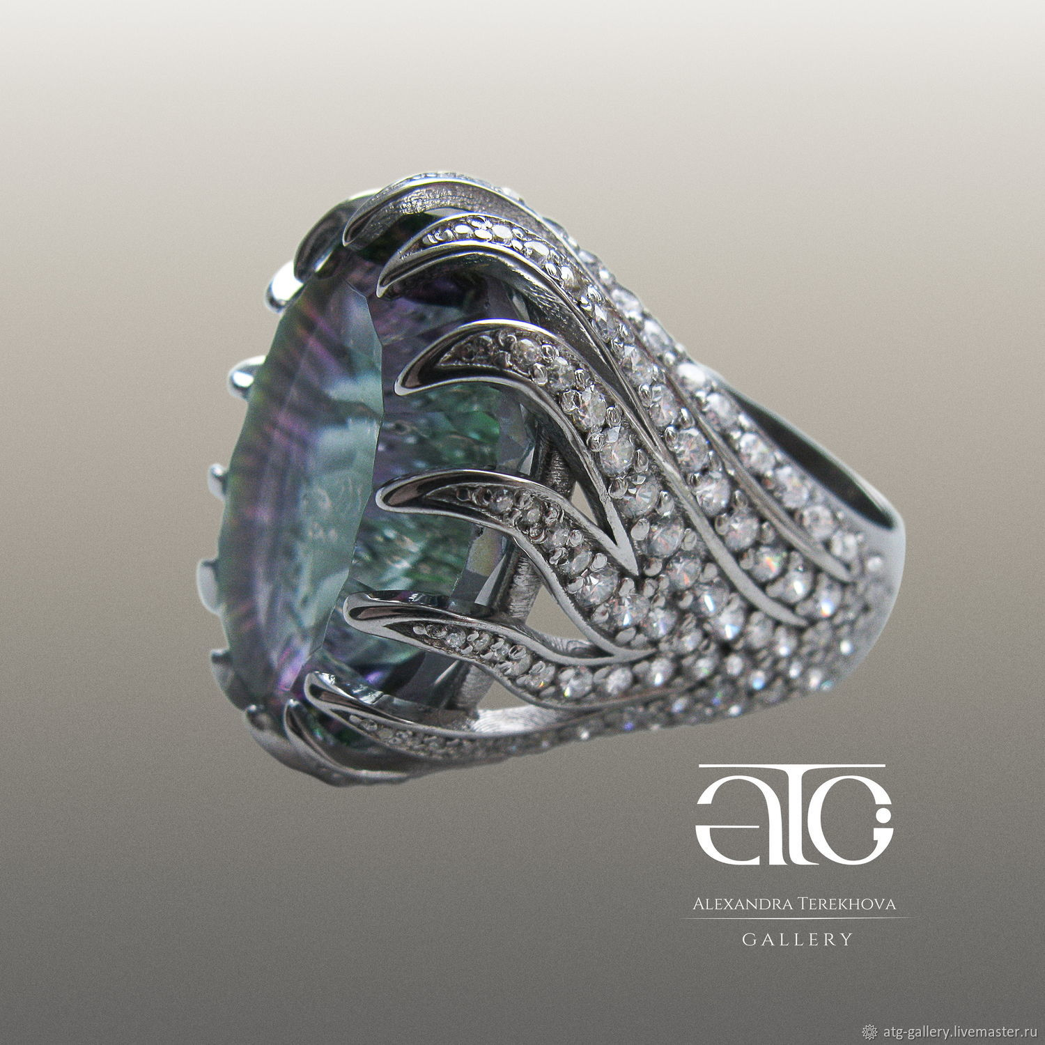 Luxurious large ring with colored mystic Topaz 34.41 Carat and cubic Zirconia 200 PCs.
