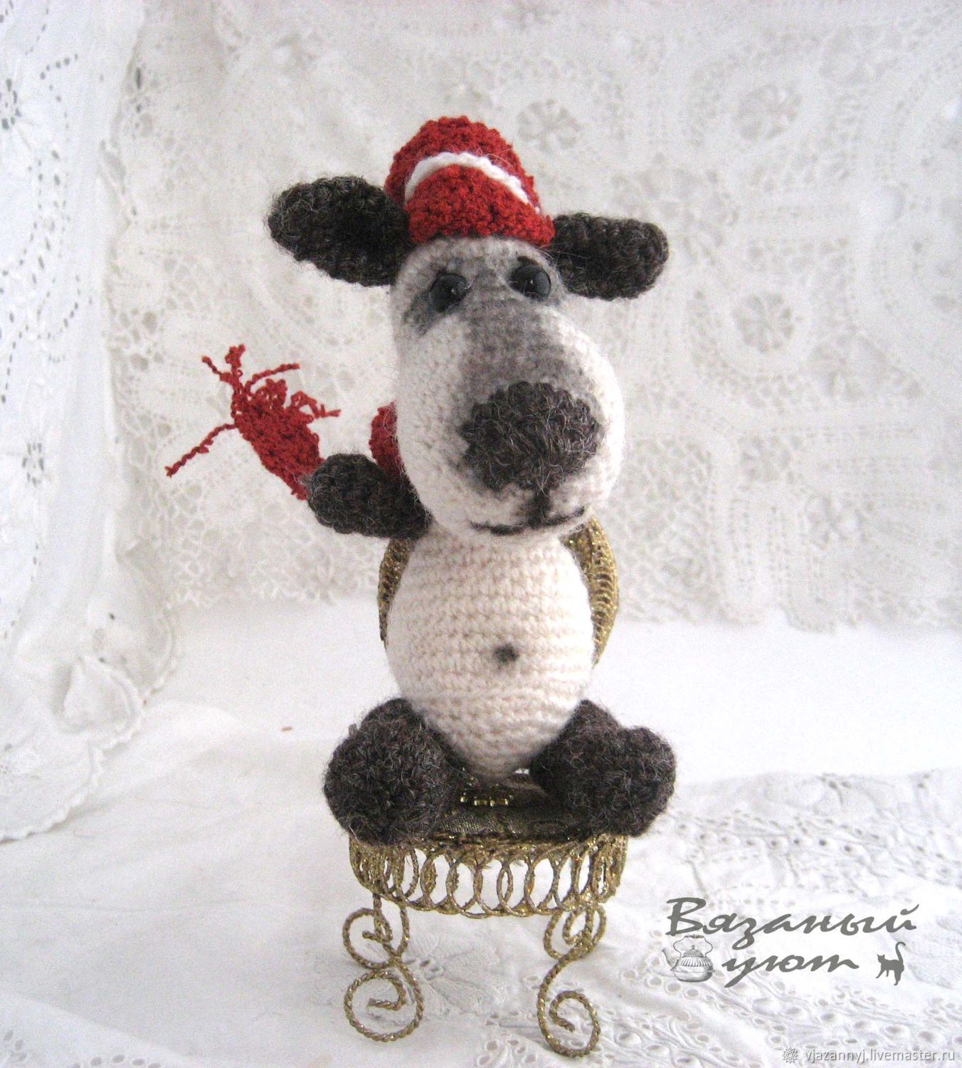Brooding dog of Sir Henry. Knitted dog. The symbol of the New year ...