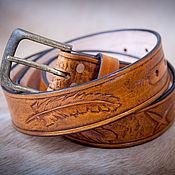 Аксессуары handmade. Livemaster - original item A genuine leather belt with embossed pattern feather. Handmade.